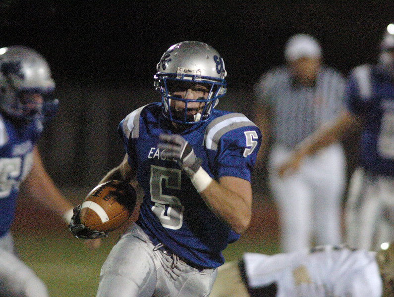 Broomfield's Dan Geubelle runs downfield for a touchdown against Greeley West during Friday's game at Elizabeth Kennedy Stadiium.<br /> <br /> October 1, 2010<br /> staff photo/David R. Jennings