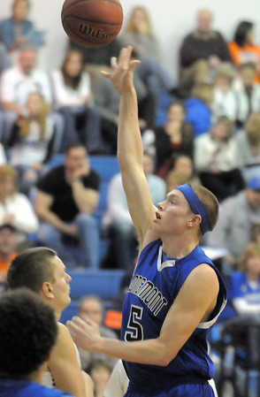 """Longmont's Josh Cogdill goes to the basket against Broomfield during Friday's game at Broomfield.<br /> For more photos please see  <a href=""""http://www.broomfieldenterprise.com"""">http://www.broomfieldenterprise.com</a>.<br /> January 12, 2012<br /> staff photo/ David R. Jennings"""