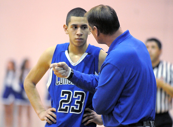 """Longmont's Brian Donaire listens to head coach Jeff Kloster during Friday's game against Broomfield at Broomfield.<br /> For more photos please see  <a href=""""http://www.broomfieldenterprise.com"""">http://www.broomfieldenterprise.com</a>.<br /> January 12, 2012<br /> staff photo/ David R. Jennings"""