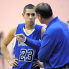 "Longmont's Brian Donaire listens to head coach Jeff Kloster during Friday's game against Broomfield at Broomfield.<br /> For more photos please see  <a href=""http://www.broomfieldenterprise.com"">http://www.broomfieldenterprise.com</a>.<br /> January 12, 2012<br /> staff photo/ David R. Jennings"