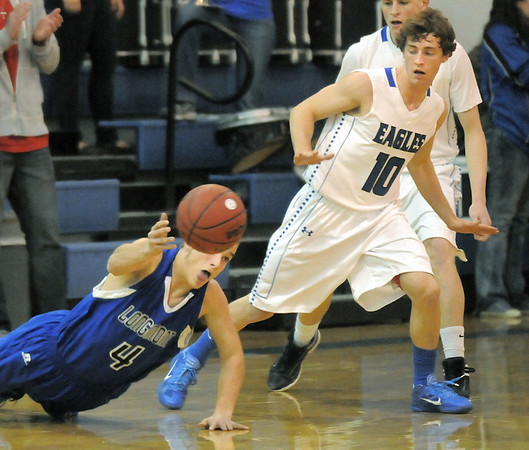 """Longmont's Jordan Johnson reaches for a loose ball past Broomfield's Austin Wood during Friday's game at Broomfield.<br /> For more photos please see  <a href=""""http://www.broomfieldenterprise.com"""">http://www.broomfieldenterprise.com</a>.<br /> January 12, 2012<br /> staff photo/ David R. Jennings"""