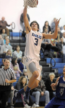 "Broomfield's Nick Ongarato goes to the basket against Longmont during Friday's game at Broomfield.<br /> For more photos please see  <a href=""http://www.broomfieldenterprise.com"">http://www.broomfieldenterprise.com</a>.<br /> January 12, 2012<br /> staff photo/ David R. Jennings"