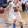 "Broomfield's Austin Wood drives the ball down court against Longmont during Friday's game at Broomfield.<br /> For more photos please see  <a href=""http://www.broomfieldenterprise.com"">http://www.broomfieldenterprise.com</a>.<br /> January 12, 2012<br /> staff photo/ David R. Jennings"