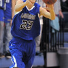 "Longmont's Brian Donaire passes the ball down court against Broomfield during Friday's game at Broomfield.<br /> For more photos please see  <a href=""http://www.broomfieldenterprise.com"">http://www.broomfieldenterprise.com</a>.<br /> January 12, 2012<br /> staff photo/ David R. Jennings"