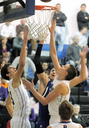 """Broomfield's Nick Ongarato and Spenser Reeb go to the basket against Longmont's Reilly Mau during Friday's game at Broomfield.<br /> For more photos please see  <a href=""""http://www.broomfieldenterprise.com"""">http://www.broomfieldenterprise.com</a>.<br /> January 12, 2012<br /> staff photo/ David R. Jennings"""
