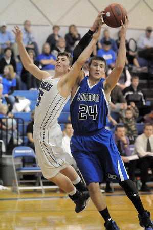 """Longmont's  Reilly Mau keeps the ball from Broomfield's Evan Kihn during Friday's game at Broomfield.<br /> For more photos please see  <a href=""""http://www.broomfieldenterprise.com"""">http://www.broomfieldenterprise.com</a>.<br /> January 12, 2012<br /> staff photo/ David R. Jennings"""