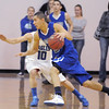 "Longmont's Brian Donaire dribbles the ball past Broomfield's Austin Wood during Friday's game at Broomfield.<br /> For more photos please see  <a href=""http://www.broomfieldenterprise.com"">http://www.broomfieldenterprise.com</a>.<br /> January 12, 2012<br /> staff photo/ David R. Jennings"