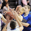 "Broomfield's Nick Ongarato, left, Dan Perse and Spenser Reeb fight for the ball with Longmont's Zach Rossi during Friday's game at Broomfield.<br /> For more photos please see  <a href=""http://www.broomfieldenterprise.com"">http://www.broomfieldenterprise.com</a>.<br /> January 12, 2012<br /> staff photo/ David R. Jennings"