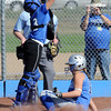 Chandler Moore, right, Broomfield, slides plate past catcher Erin Lackey, Longmont, during play at Broomfield High Saturday.<br /> Sept. 26, 2009<br /> Staff photo/David R. Jennings