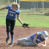 Sarah Fabrizio, right, Broomfield, slides to second base as Sam Keller, Longmont, catches the ball during play at Broomfield High Saturday.<br /> <br /> Sept. 26, 2009<br /> Staff photo/David R. Jennings