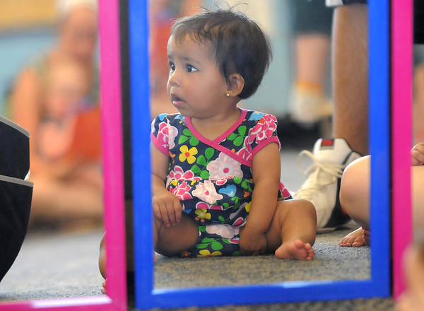 Leslie Harrison, 11 months-old, sits in front of mirrors during the Early Literacy Fair at the Mamie Doud Eisenhower Public Library on Saturday.<br /> <br /> July 15, 2011<br /> staff photo/ David R. Jennings