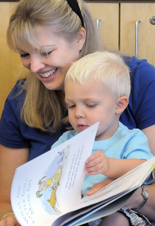 Amy Tabor reads to her son Cody, 2 1/2, during the Early Literacy Fair at the Mamie Doud Eisenhower Public Library on Saturday.<br /> July 15, 2011<br /> staff photo/ David R. Jennings