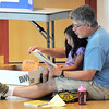 Guy Shaffer reads to his daughter Grace, 5, during the Early Literacy Fair at the Mamie Doud Eisenhower Public Library on Saturday.<br /> <br /> July 15, 2011<br /> staff photo/ David R. Jennings