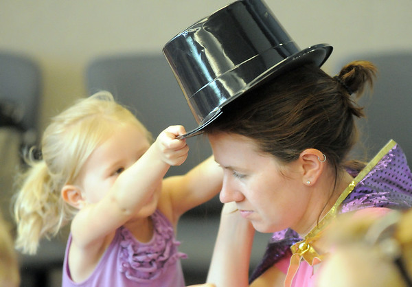 Erica Derby receives a top hat courtesy of her 2 year old daughter Quinn during the Early Literacy Fair at the Mamie Doud Eisenhower Public Library on Saturday.<br /> <br /> July 15, 2011<br /> staff photo/ David R. Jennings