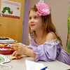 Lily Conly, 5, colors a paper puppet during the Early Literacy Fair at the Mamie Doud Eisenhower Public Library on Saturday.<br /> <br /> July 15, 2011<br /> staff photo/ David R. Jennings