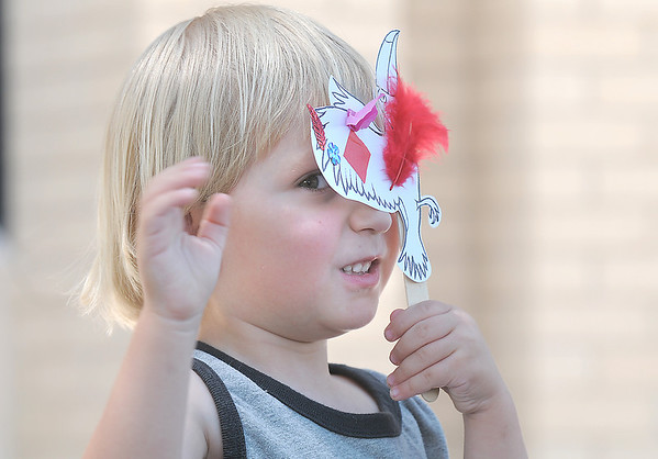 Connor McGarvey, 3, plays with a paper bird puppet during story telling at the Early Literacy Fair at the Mamie Doud Eisenhower Public Library on Saturday.<br /> <br /> <br /> July 15, 2011<br /> staff photo/ David R. Jennings