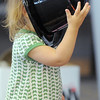 Dayli Romir-Leavitt, 19 months-old, tries on a top hat during the Early Literacy Fair at the Mamie Doud Eisenhower Public Library on Saturday.<br /> <br /> July 15, 2011<br /> staff photo/ David R. Jennings