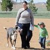 Ann Daniel, center, walks with Mojo, left, and her son Xander, 2, after the Paws in the Park egg hunt and Easter bonnet parade at the Broomfield County Commons Dog Park on Saturday.<br /> April 7, 2012 <br /> staff photo/ David R. Jennings