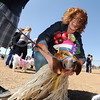 Ceecee Stussi dresses the family dog, George, in the winning costume for 1st place in the bonnet parade during the Paws in the Park egg hunt and Easter bonnet parade at the Broomfield County Commons Dog Park on Saturday.  <br /> April 7, 2012 <br /> staff photo/ David R. Jennings