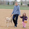 Diane Zissler and her daughter Priya, 3, with their dog Buster, look for doggie Easter eggs during the Easter Egg Hunt for Dogs at the Broomfield County Commons Dog Park on Saturday.<br /> <br /> April 23, 2011<br /> staff photo/David R. Jennings