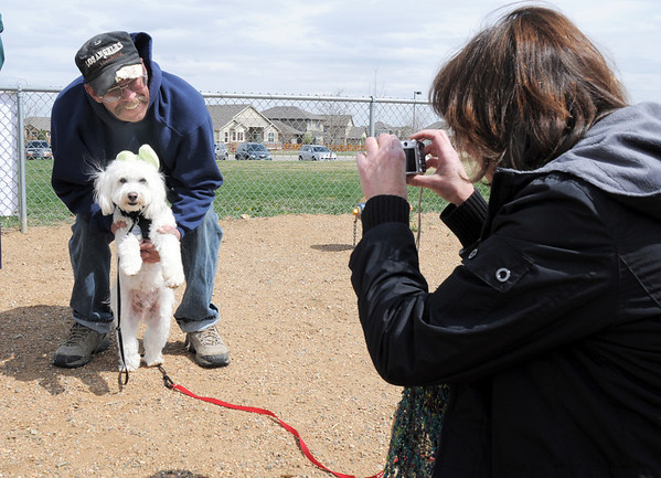 Mark Taylor holds Toby while having their picture taken by owner Linda Whittington during the Easter Egg Hunt for Dogs at the Broomfield County Commons Dog Park on Saturday.<br /> <br /> April 23, 2011<br /> staff photo/David R. Jennings