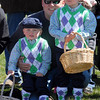 Dressed as golfers, Grant, 3, left, Blake, 5, Niemann with their father Eric wait for their turn at the 16th Annual Egg Scramble at Community Park on Saturday.<br /> <br /> April 3, 2010<br /> Staff photo/David R. Jennings