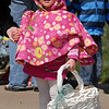 Dressed for the wind Jacque Steven, 2, holds her basket for the 16th Annual Egg Scramble at Community Park on Saturday.<br /> Over 1000 children, families and friends attended the event.<br /> April 3, 2010<br /> Staff photo/David R. Jennings