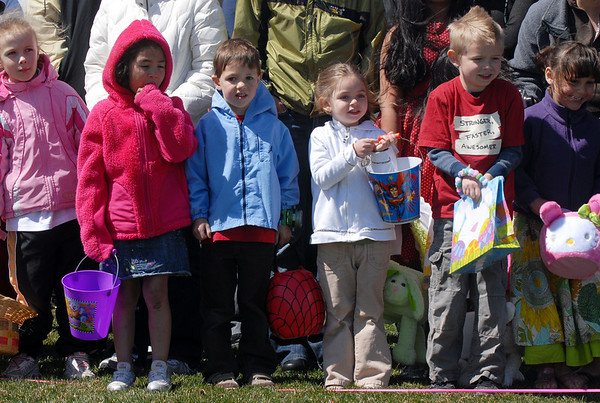 Children in the 5-6 year-old group wait for the signal to gather plastic eggs and candy during the 16th Annual Egg Scramble at Community Park on Saturday.<br /> April 3, 2010<br /> Staff photo/David R. Jennings