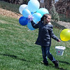 Riana Zinn 7, walks up a slope with her basket and balloons after the 16th Annual Egg Scramble at Community Park on Saturday.<br /> <br /> April 3, 2010<br /> Staff photo/David R. Jennings