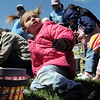 Reese Goff, 1, looks at her parents while picking plastic eggs and candy during the 16th Annual Egg Scramble at Community Park on Saturday.<br /> <br /> April 3, 2010<br /> Staff photo/David R. Jennings