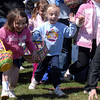 Sheridan Toone, 4, center, runs to get her share of candy during the 16th Annual Egg Scramble at Community Park on Saturday.<br /> Over 1000 children, families and friends attended the event.<br /> April 3, 2010<br /> Staff photo/David R. Jennings