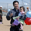 Febi Yuwono holds his daughter Karlie Chandra, 18 months-old after the 16th Annual Egg Scramble at Community Park on Saturday.<br /> April 3, 2010<br /> Staff photo/David R. Jennings