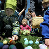 Children in the 0-2 age group pick plastic eggs and candy with the help of a parent during the 16th Annual Egg Scramble at Community Park on Saturday.<br /> Over 1000 children, families and friends attended the event.<br /> April 3, 2010<br /> Staff photo/David R. Jennings