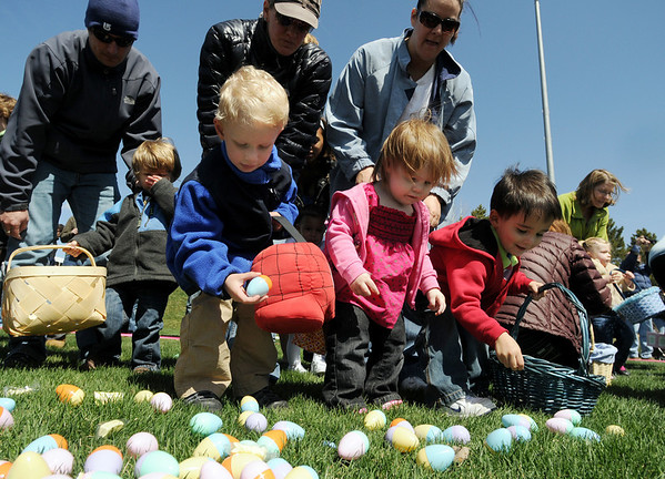 Children under the watchful eyes of their parents gather plastic eggs and candy during the 16th Annual Egg Scramble at Community Park on Saturday.<br /> <br /> April 3, 2010<br /> Staff photo/David R. Jennings