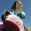 Viviana Cromer, 4, looks for more plastic eggs and candy to fill her basket during the 16th Annual Egg Scramble at Community Park on Saturday.<br /> <br /> April 3, 2010<br /> Staff photo/David R. Jennings