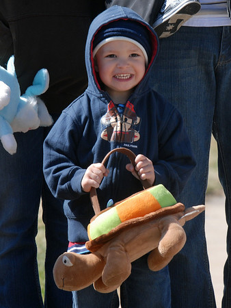 Garrett Burke, 3, is excited seeing Flopsy the Easter Bunny before the 16th Annual Egg Scramble at Community Park on Saturday.<br /> <br /> April 3, 2010<br /> Staff photo/David R. Jennings
