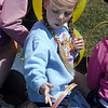 Sheridan Toone, 4, eats some of her candy loot after the 16th Annual Egg Scramble at Community Park on Saturday.<br /> <br /> April 3, 2010<br /> Staff photo/David R. Jennings
