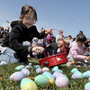 Halina Halbeisen, 6,  gathers plastic eggs and candy during the 16th Annual Egg Scramble at Community Park on Saturday.<br /> Over 1000 children, families and friends attended the event.<br /> April 3, 2010<br /> Staff photo/David R. Jennings