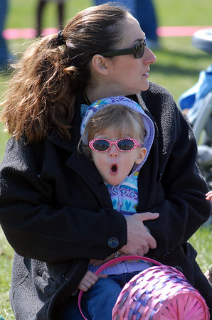 Darlene Cole keeps her daughter Allison, 2, warm from the wind while waiting for the 16th Annual Egg Scramble at Community Park on Saturday.<br /> Over 1000 children, families and friends attended the event.<br /> April 3, 2010<br /> Staff photo/David R. Jennings