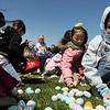 Children in the 3-4 year old group gather candy and plastic eggs during the 16th Annual Egg Scramble at Community Park on Saturday.<br /> <br /> April 3, 2010<br /> Staff photo/David R. Jennings