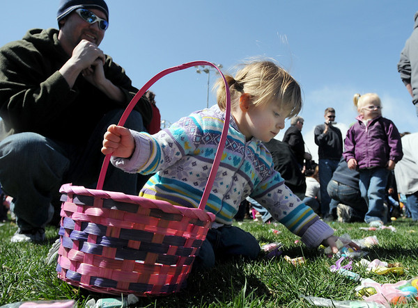 Kaitly Cole, 2, gathers plastic eggs and candy while her father Daniel watches during the 16th Annual Egg Scramble at Community Park on Saturday.<br /> <br /> April 3, 2010<br /> Staff photo/David R. Jennings