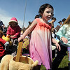 Hailey Visbal, 4, looks for plastic eggs and candy to put in her basket during the 16th Annual Egg Scramble at Community Park on Saturday.<br /> Over 1000 children, families and friends attended the event.<br /> April 3, 2010<br /> Staff photo/David R. Jennings