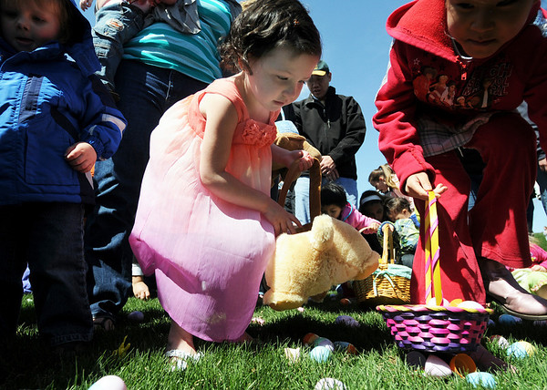 Hailey Visbal, 4, fills her basket during the 16th Annual Egg Scramble at Community Park on Saturday.<br /> <br /> April 3, 2010<br /> Staff photo/David R. Jennings
