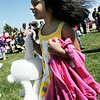 Anwita Gundu, 5, looks for her parents after filling her basket during the 16th Annual Egg Scramble at Community Park on Saturday.<br /> <br /> April 3, 2010<br /> Staff photo/David R. Jennings