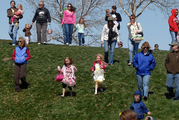 Children and parents walk down the slope to the 16th Annual Egg Scramble at Community Park on Saturday.<br /> Over 1000 children, families and friends attended the event.<br /> April 3, 2010<br /> Staff photo/David R. Jennings