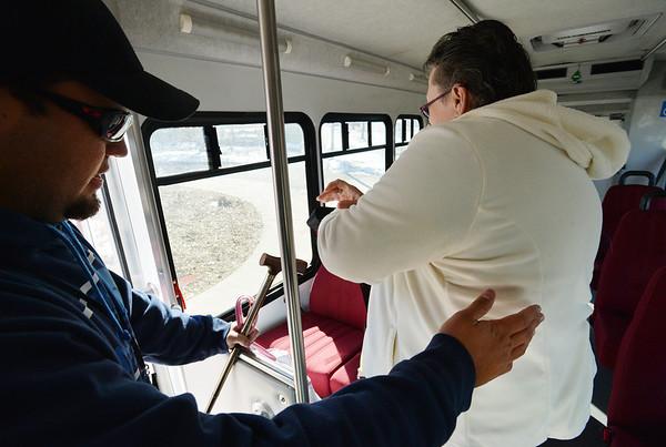 Driver Brett Hoag, left, helps Marilyn Kay Johnson to her seat on the Easy Ride bus at Broomfield Senior Center on Friday.<br /> January 4, 2013<br /> staff photo/ David R. Jennings