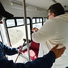 Driver Brett Hoag, left, helps Marilyn Kay Johnson to her seat on the Easy Ride bus at Broomfield Senior Center on Friday.<br /> January 4, 2013<br /> staff photo/ David R. Jennings