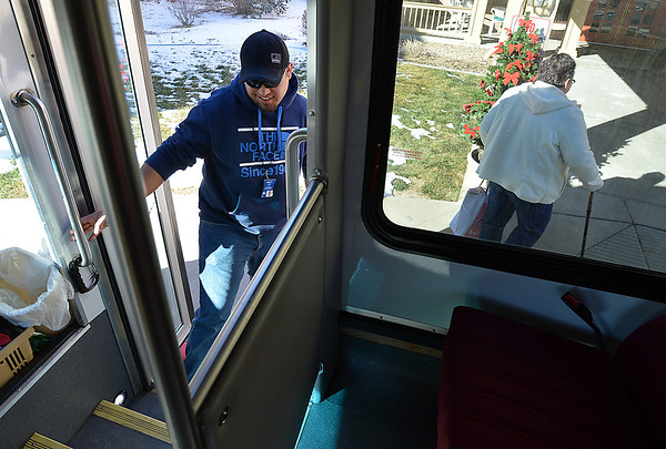 Driver Brett Hoag, left, boards his Broomfield Senior Center Easy Ride bus after dropping Marilyn Kay Johnson, right, at the Silver Crest Apartments on Friday.<br /> January 4, 2013<br /> staff photo/ David R. Jennings