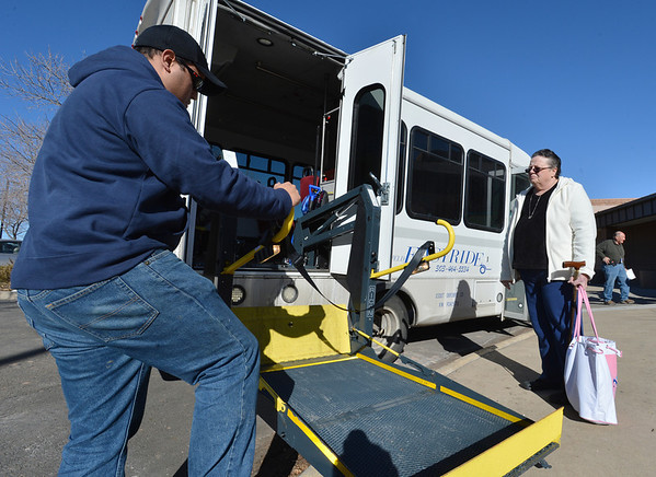 Easy Ride driver Brett Hoag, left, prepares the lift for Marilyn Kay Johnson to board the bus at Broomfield Senior Center on Friday.<br /> January 4, 2013<br /> staff photo/ David R. Jennings