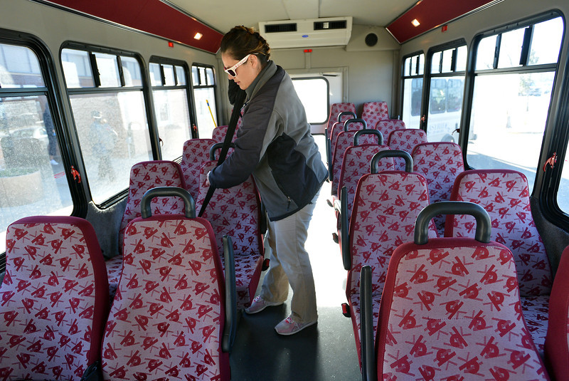 Easy Ride driver Monica Verdin checks the passenger's seat belts in her bus before driving seniors to at from the Broomfield Senior Center on Friday.<br /> January 4, 2013<br /> staff photo/ David R. Jennings